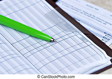 Open checkbook with credit card statement