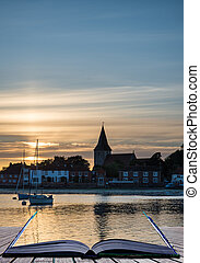 Landscape tranquil harbour at sunset with yachts in low tide Cre