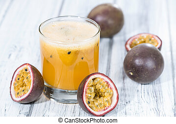 Fresh made Maracuja Juice on wooden background (close-up...