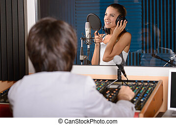 Recording Studio - Young female singer with studio...