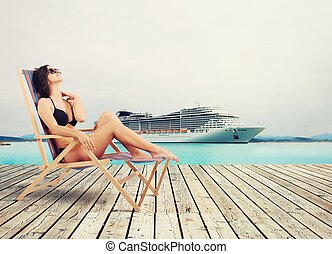 Cruise vacation - Girl relaxing on holiday with cruise ship