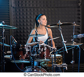 Recording Studio - Girl behind drum-type installation in a...