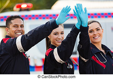 paramedic team high five - cheerful paramedic team high five