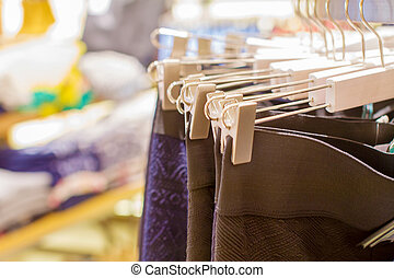 Preview ladies skirts hanging on display - a Preview ladies...
