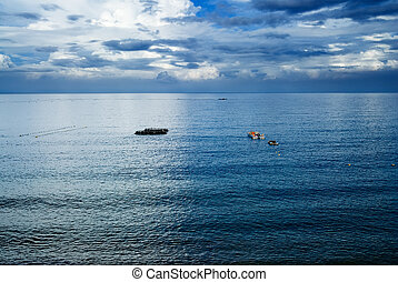 fishing boats on the ocean - It is beautiful sky and ocean...