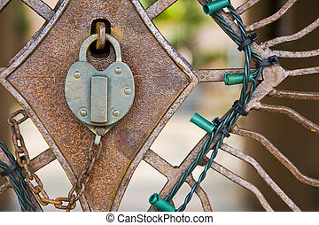 Old Lock and Gate - Old lock and gate with Christmas lights