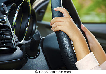 car control  - Hands of children are caught up in force.