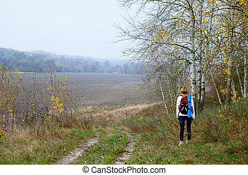 Woman traveler relax on the autumn nature