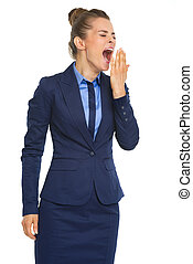 Tired business woman yawning