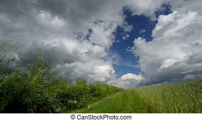 Time lapse country road and scenic clouds. Spring day in...