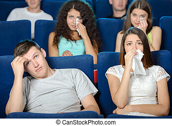 Movie Theater - Exciting movie Young people eating popcorn...