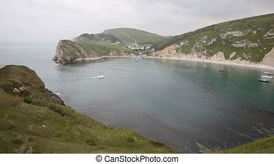 Boats in Lulworth natural harbour - Lulworth Cove Dorset...