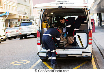 paramedics offloading patient from ambulance - paramedics...