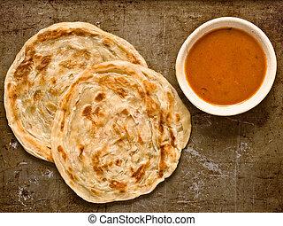 rustic indian roti prata - close up of rustic indian roti...