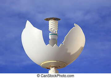 broken by vandalism lamp with energy saving light bulb