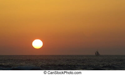Sailboat crosses the horizon during - A sailboat crosses the...