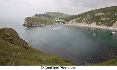 Boats in Lulworth Cove harbour - Lulworth Cove Dorset...
