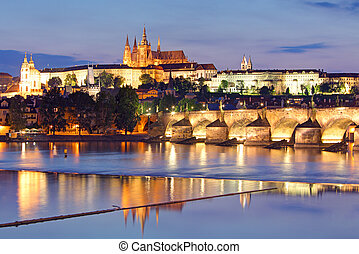 Prague castle and Charles bridge at night