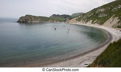Boats in Lulworth Cove Dorset uk - Lulworth Cove Dorset...