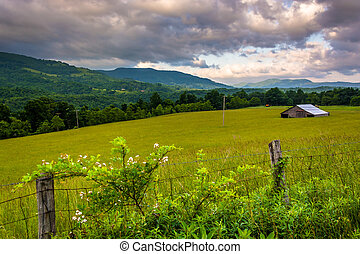 Fence and morning view of mountains in the rural Potomac...