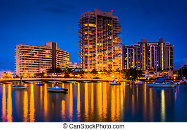 Buildings on Belle Island at night, in Miami Beach, Florida....
