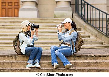 tourists photographing each other