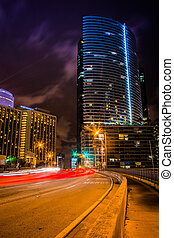 Traffic on Brickell Avenue at night, in downtown Miami, Florida.