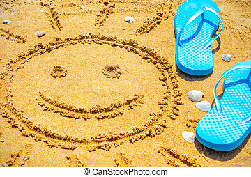 The sun drawn on sand and blue beach Slippers