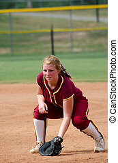Girl playing softball - Close up of girl covering first base...