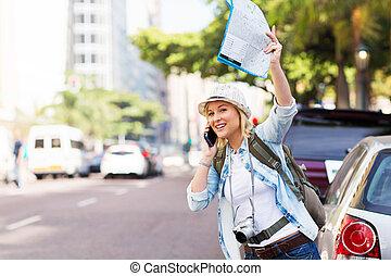 tourist hailing a taxi