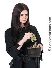 Wicked witch - Wicked young witch with a potion in a...