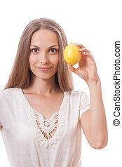 young woman holding a lemon - young woman holding a yellow...