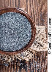 Poppyseed - Portion of fresh Poppyseed (detailed close-up...