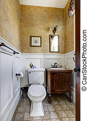 Small bathroom interior with antique vanity cabinet - White...