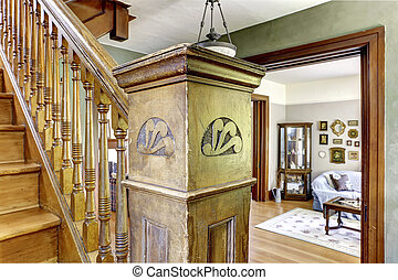 Old staircase with wooden carved pole