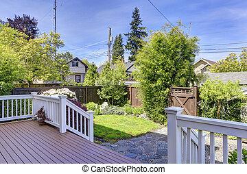 House walkout deck and backyard garden