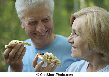 Mature couple eat pizza - Portrait of mature couple eat...