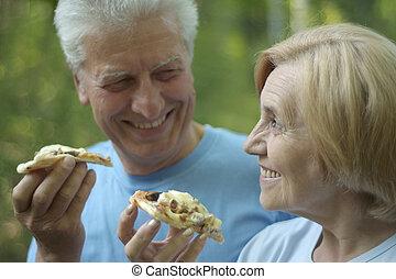 Mature couple eat pizza - Portrait of mature couple eat...