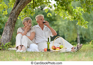 loving older couple spending time together outdoors
