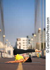 Woman doing stretching yoga exercis