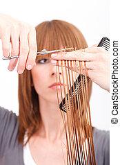 Hair Cut - Hairdresser cutting the hair of a blonde woman