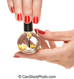 Woman hands with manicured red nails closeup Skin and nail...