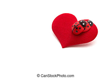 Love making ladybugs couple on the red heart . Creative...