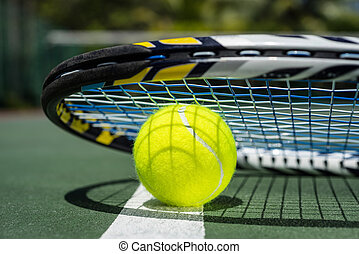 Close up view of tennis racket and balls on the clay tennis...
