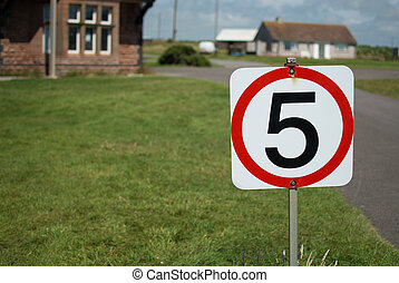 Five miles per hour sign - A five miles per hour sign on a...