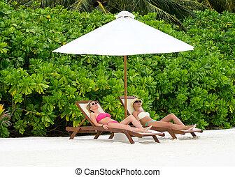 Beautiful girls relaxing on a beach