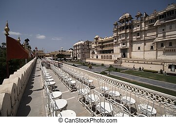 Udaipur City Palace - Seats lining a terrace facing the main...