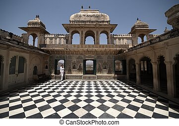 Courtyard of Indian Palace - Painted murals on the walls of...