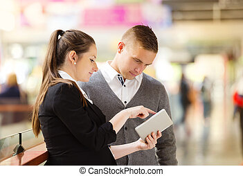 Business meeting in shopping mall - Businessman and...