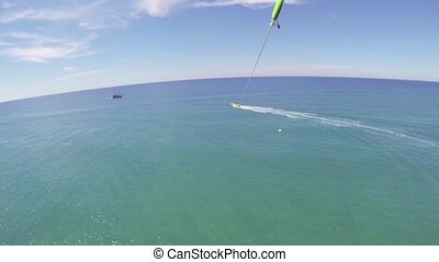 Parasailing. Bird's eye view - Parasailing. Aerial view....